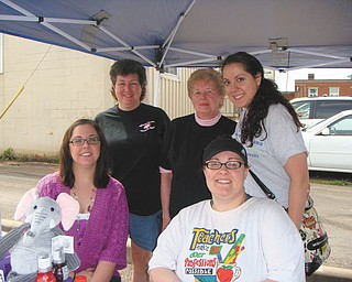 SPECIAL TO THE VINDICATOR Members of the Girard Junior Women's Club, seated, from left, Angela Lee and Kendra Allen, and standing, from left, Laura Sobnosky, Martha Altier and Dorothy Gerthung, prepare for the club's annual Trunk and Treasure Sale. The event will take place rain or shine from 10 a.m. to 2 p.m. May 11 at 100 N. Market St. in Girard. The location is a Girard City lot across from the city building and is visible from state Route 422. Vendors will include those selling crafts, new items and garage sale items in an eclectic mix. To secure a vendor spot at $10 each, call 330-545-5962.