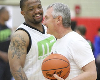 William D. Lewis\The Vindicator Maurice Clarett, left, and Jem Tressel dubring Comeback event Saturday in Struthers..