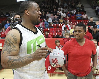 William D. Lewis\The Vindicator Maurice Clarett signs autograph for Jovan Adams, 10, of Youngsotwn during Comeback event in Struthers 4-27-13..