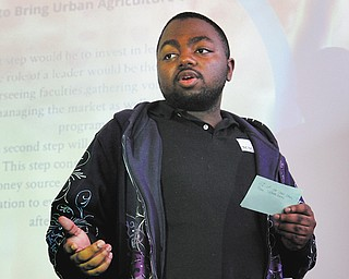 Denzel Stevens presents his senior project on Urban Agriculture in Warren for Inspiring Minds, a program