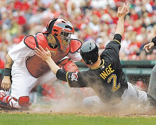 The Pirates' Brandon Inge (2) scores ahead of the tag by Cardinals catcher Yadier Molina during the sixth inning of Sunday's game in St. Louis. Pittsburgh shut out St Louis, 9-0
