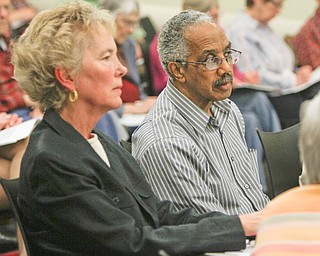 Maggy Lorenzi of Youngstown, a community activist, and Richard Atkinson, president of the Youngstown school board, were among those attending a session Monday on open-records and open-meetings laws.