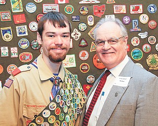 Eagle Scout Robert McKay and his father, Trumbull County Common Pleas Judge W. Wyatt McKay, at the Arrowhead District's Friends of Scouting Breakfast Monday at Leo's Ristorante in Howland. Robert, 17, is one of fewer than 200 in Boy Scouts of America history to earn 133 merit badges — and he expects to complete requirements for his final two in a few weeks.