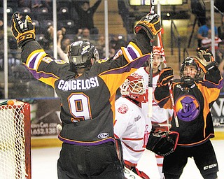 The Phantoms' Austin Cangelosi (9) and Cam Brown (8) celebrate after Cangelosi cored Youngstown's first goal against Dubuque during the first period of Game 3 of the USHL Eastern Conference final on Monday at the Covelli Centre. Down 3-1 after two periods, the Phantoms rallied, scoring three goals in the final period to win 4-3 and avoid elimination. Dubuque leads the series, 2-1. Game 4 is tonight.