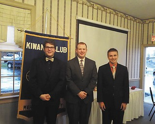 SPECIAL TO THE VINDICATOR From left to right are Brandon Brooks, Coach Jeremy Hamilton and Tim Nesnidol, representatives of the Canfield High School Speech Team who recently presented a program at Kiwanis of Western Mahoning County's meeting. Brooks performed in the area of prose and poetry, and Nesnidol in the area of humor. Hamilton said the team has won many local and state awards this year. Upcoming speakers are Elida Cowles of Shepherd of the Valley, today; Division 21 meeting at A La Cart Catering in Canfield, May 15; Bertram DeSouza, Vindicator writer, May 29; Heidi Daniel, director, and Debbie Liptak, development director, of the Public Library of Youngstown and Mahoning County on June 26. For information call 330-502-1460 or email cfsmith99@yahoo.com.