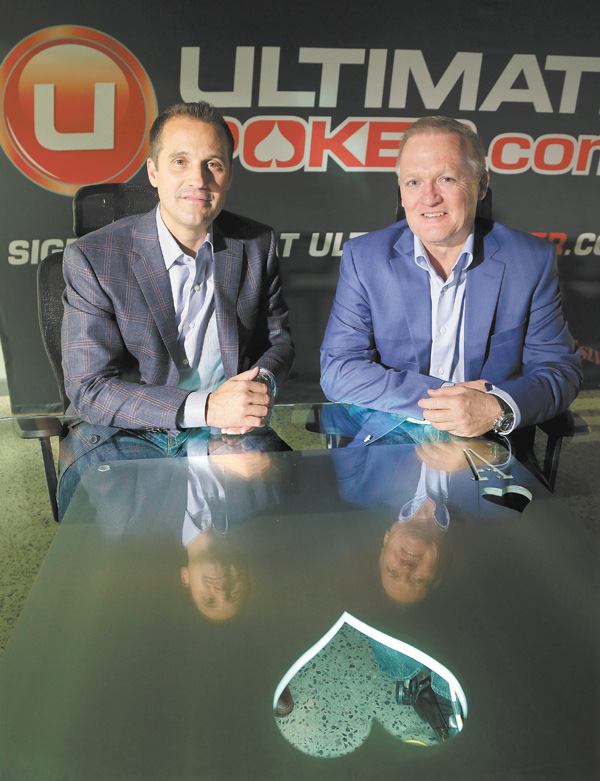 Ultimate Gaming chairman Tom Breitling, left, and CEO Tobin Prior sit for a photo at their company headquarters in Las Vegas on Monday. The social-gaming company launched the first legal, real-money poker site in the U.S. on Tuesday.