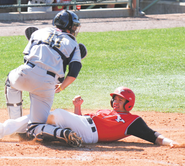 Youngstown State's Nick DiNello is tagged out at home by Kent State catcher Tommy Monnot during Wednesday's game at Eastwood Field. The Golden Flashes edged the Penguins, 9-8.
