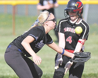 Canfield's Sydney Opladen is safe after stealing second base as Lakeview's Taylor Waid misses the throw during their game Thursday in Canfield. The Cardinals cruised to a 7-3 win over the Bulldogs behind senior Abby Baker, who pitched a two-hitter and struck out four batters.