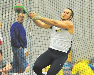 Kent State University's Matthias Tayala throws the hammer during the state indoor track meet Feb. 16. Tayala, a McDonald High graduate, put up the best mark and earned gold for the Flashes at the Penn Relays on April 24 with a throw of 217.8 feet.