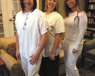 Tristess Patrick, left, Marie Turner and Brianna Carpenter are all nurses at Windsor House at Champion Estates Assisted Living in Warren. Not pictured are Nuri Reed and Sarah George. The photo was taken by Krista Reese, director at the facility, and submitted by Dan Rowland, director of marketing.