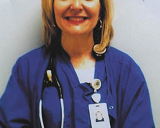 Pam Carroll of New Middletown, a nurse in the surgery department at St. Elizabeth Health Center, has received Employee of the Month and Employee of the Year at St. E's. Granddaughter Grace Burchfield, also of New Middletown, submitted this photo.