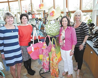 SPECIAL TO THE VINDICATOR Hard work goes into organizing Girls Night Out, an annual event that helps to support Fellows Riverside Gardens in Mill Creek Park. Some of those involved are, from left, Jody Vernal, Sharon Carbon and Janey Donadee, Girls Night Out committee members and board members of Friends of Fellows Riverside Gardens; and Jeanne Simeone, buyer for the Shop in the Gardens. Because the annual event has proved to be so popular and sells out quickly, they have decided to extend the show to two days this year. Patrons of Girls Night Out can choose May 21 or 22.