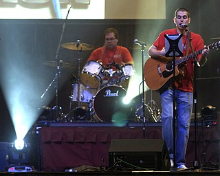 """Kelli Cardinal/The Vindicator Brandon Matteson (right) of Greenford Christian Church, performs Saturday with one of the church's praise and worship groups during the Men's Rally in the Valley at the Covelli Center in Youngstown.  The group performed a number of songs including one called """"More than Amazing."""""""