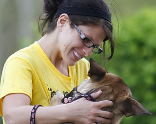 MADELYN P. HASTINGS | THE VINDICATOR  Danielle Williamson of North Jackson embraces her German Shepherd, Chassie, at the 1st annual Tails on Trails 5K walk at Austintown Township Park. All proceeds benefit Friends of Fido Mahoning County Dog Pound.