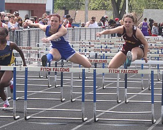 NICK MAYS l THE VINDICATOR  Sage Spotleson of Poland and Ashley Pryce of Stow race to the finish in the 100 meter hurdles Saturday afternoon in Austintown. 05042013 austintown, ohio