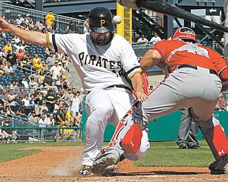Nationals catcher Wilson Ramos (40) cannot handle the relay throw and the Pirates' Gaby Sanchez scores on