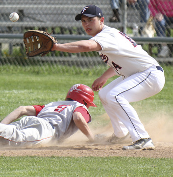 William D. Lewis\The Vindicator NilesTyler Weiry(8) gets back to first ahead of throw during a pickoff attempt. Making catch for Fitch is Phil socha(14).