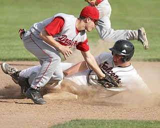 William d Lewis the vindicator Fitch's Phil Socha (14) steals 2nd as Niles Jacob Foster(3) tries to mamke the tag during 5-6-13 game at Fitch.