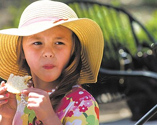 Kennedy Collinsworth, 6, of Boardman eats her lunch Sunday during the Mommy & Me for Tea and Fashion Show at Lariccia Family Community Center in Boardman Park. Kennedy, who was at the event with her mother and grandmother, also plays with a tea set at home that's been passed down to her from her grandma.