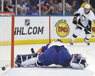 Pittsburgh Penguins left wing James Neal (18) watches as his shot goes past New York Islanders goalie Evgeni Nabokov (20) in the first period of Game 4 of their series Tuesday night at Nassau Coliseum.