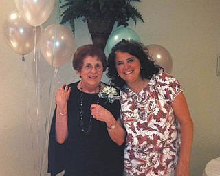 Pamela Pasquale and her mother, Janet Rozzo. Pamela says ÒIt brings a smile to my face just thinking of childhood memories of days sitting ÒIndian-styleÓ on our yellow-gold linoleum floor waiting for my mom to join us for a game of jacks Ñ with real metal jacks and a red rubber ball.