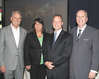 Greg Greenwood, owner of Greenwood Chevrolet in Austintown, left, received the Community Partner Award on Wednesday at the annual meeting of The Community Corp., United Way's parent, at The Lake Club in Poland. Also attending the meeting were, from left, Becky Wall, 2013 campaign chairwoman; Theodore Schmidt, 2012 campaign chairman, and Robert Hannon, United Way president.