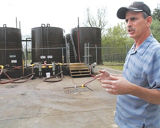 David Ballentine, president of Northeast Ohio Oilfield Service Inc., stands at the storage facility of his injection-well site in Windham, where fracking wastewater is first accepted before being piped to the actual injection well a few hundred yards away.