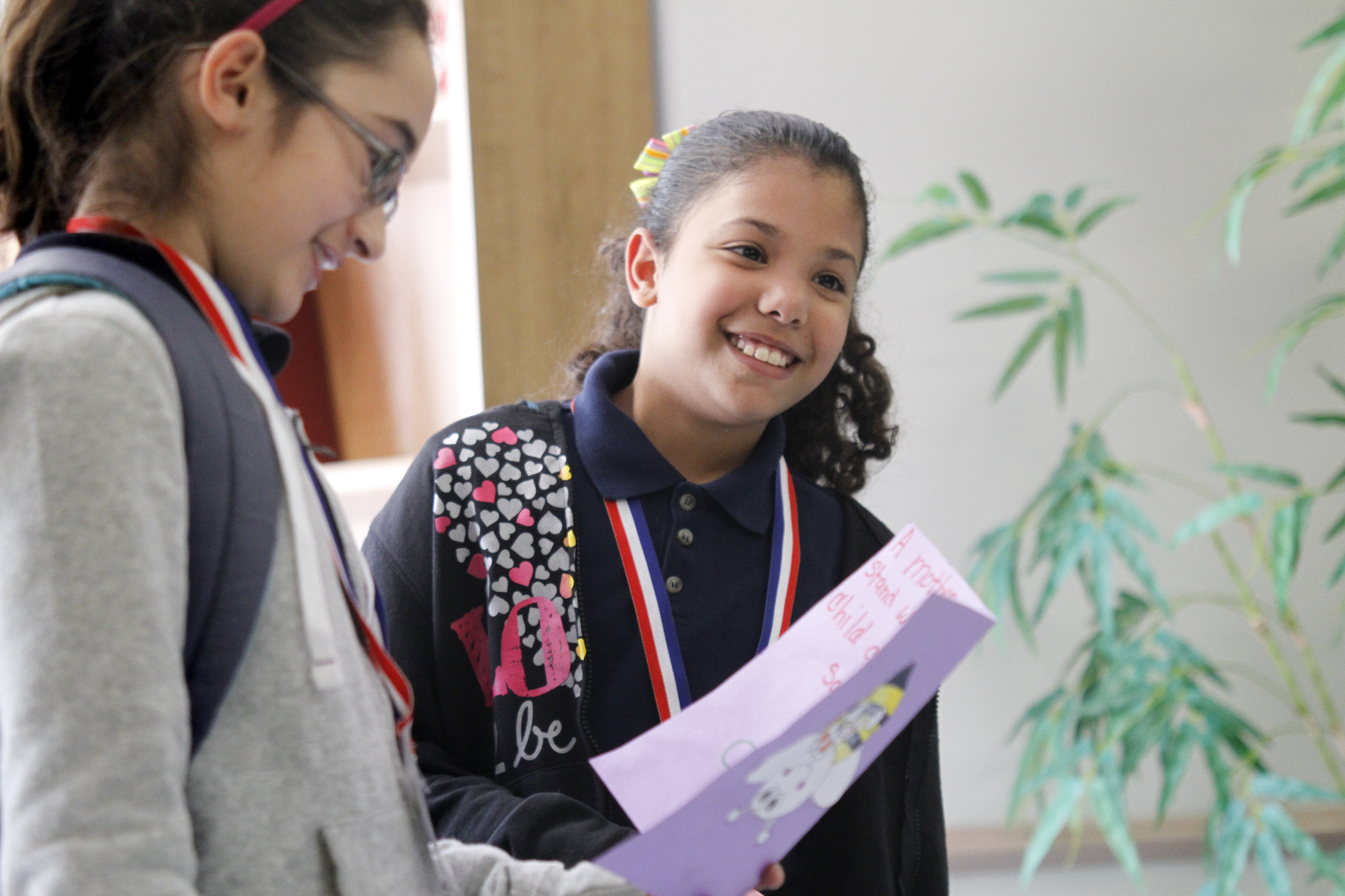 MADELYN P. HASTINGS   THE VINDICATOR   (L-R) Fifth graders Kimberly Nieves and Jailenette Morales read a Mother's Day card to residents at Danridge Nursing Home. The kids involved with the after school program at Martin Luther King Elementary presented the ladies of Danride Mother's Day cards, songs and poems.