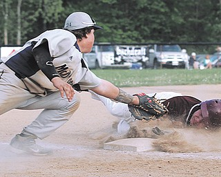 South Range baserunner Turner Curry avoids the tag by McDonald third baseman Mike Soots during the sixth inning of their baseball game Thursday at McDonald High School. The Raiders battered the Blue Devils 26-10.