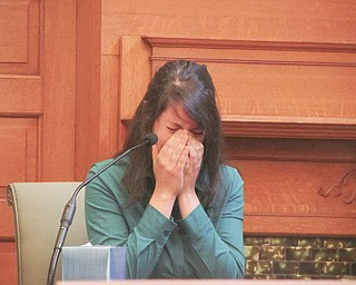Alexis Hugel of Girard cries on the witness stand Tuesday while testifying about the events of April 6, 2012, the day her best friend, Christine Sheesley, overdosed on heroin.