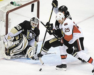 Ottawa's Chris Neil (25) battles Pittsburgh's Brooks Orpik (44) in front of Penguins goalie Tomas Vokoun (92) in the third period of Game 1 of a second-round playoff series in Pittsburgh on Tuesday night. The Penguins won 4-1.