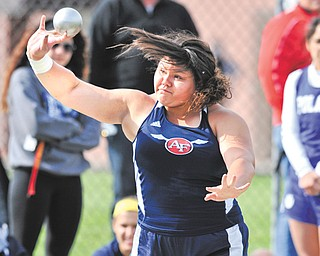 Fitch junior Gabby Figueroa puts the shot during Tuesday's All-American Conference American Division meet at Poland High School. Figueroa won the shot and discus to help the Falcons win the team title.