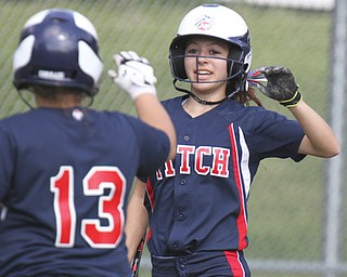 William D. Lewis\The Vindicator Fitch's Cali Mikovich(3) gets congrats from Alex Corradi(13) after scoring during 2nd inning of game with Kent. Fitch won 4-2..