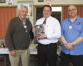 SPECIAL TO THE VINDICATOR Struthers Rotary welcomes its newest member, Joe Nohra, center, superintendent of Struthers City Schools. Rotarian Dan Becker, left, made the presentation of the Objects of Rotary and Four Way Test plaques. On the right is Tom Baringer, club president.