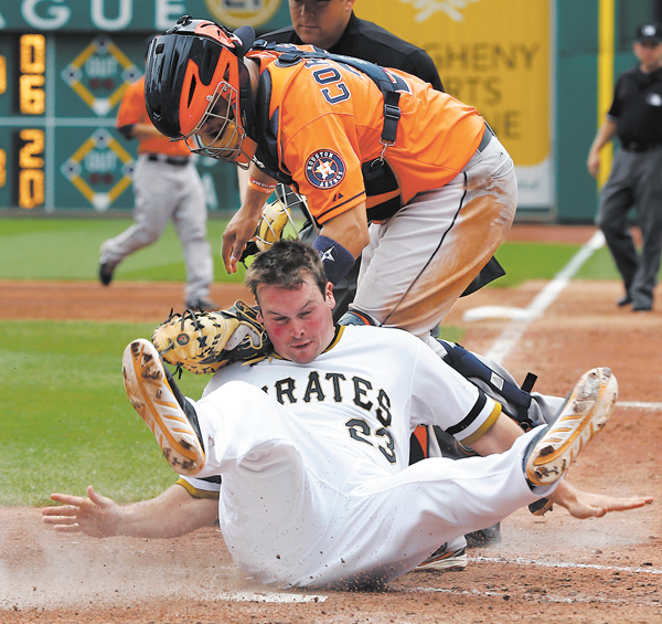 Pirates baserunner Travis Snider, bottom, rolls into Astros catcher Jason Castro after being tagged out trying to score from second on a single by Gaby Sanchez in the sixth inning of Sunday's game at PNC Park in Pittsburgh.