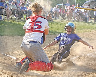 Western Reserve catcher Marley Oles blocks the plate as Jackson-Milton's Zaina Sahli tries to score during a Division IV softball semifinal Monday in Lisbon. The Bluejays ousted the Blue Devils, 8-5, and advance to the  final against Mineral Ridge.