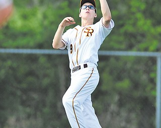 South Range outfielder Greg Dunham (9) catches a fly ball during a Division III district semifinal against Girard on Tuesday night at Cene Park in Struthers. South Range won, 3-0, and will meet Ursuline in a district  final tonight at Cene Park.