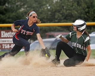 MADELYN P. HASTINGS | THE VINDICATOR   Fitch's Cali Mikovich (3) tags Aurora's Nicole Doyle (10) out on third base.   - -30-