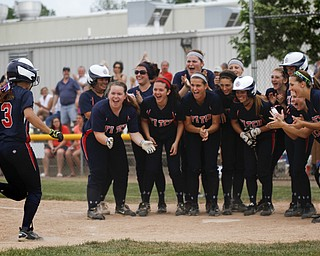 MADELYN P. HASTINGS | THE VINDICATOR   Fitch's Cali Mikovich (3) runs into her cheering teammates  after hitting a home run.