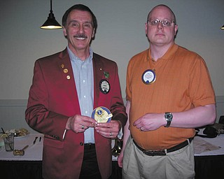 SPECIAL TO THE VINDICATOR  Boardman Lions Club received the Club Excellence Award from Lions Club International at the April membership meeting at the Magic Tree Pub and Eatery. The award is given to clubs that excel in community service, membership growth, communication and organizational management. William Rausch, right, zone chairman, gave the club banner patch and president's excellence pin to Terry Shears, King Lion. Only four clubs in the district received the award for 2011-2012.
