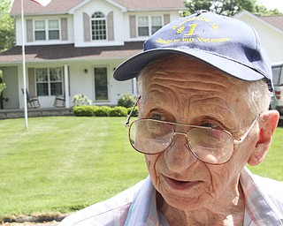 William D. Lewis\The Vindicator Meter Fromel, 85, has placed flags along his street in Austintown.