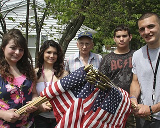 William D. Lewis\The Vindicator Posing with flags to be placed on Austintown streets are from left: Lynnette Seebacher, Laura Wilson, Meter Fromel, Ricky Ferry and Camran Rezapourian. Fromel is an 85 year old MArine vet who enlisted the help of studnetsw in Austintown Fitch NHS students.