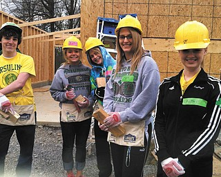 SPECIAL TO THE VINDICATOR  Ursuline High School Student Council and Students of Stewardship hosted a Day of Service on April 20. Some of the students who worked on a home for Habitat for Humanity, from left, are Dan McClurkin, Meghan Buckley, Christine Kerrigan, Mary O'Donnell and Kathryn Rosinski. Rotary Club of Youngstown provided breakfast, and more than 100 students and faculty members also worked at sites that  included Beatitude House, Dorothy Day House, St. Patrick Parish, St. Angela Merici Parish and Boardman Relay for Life. Participants received Day of Service T-shirts.