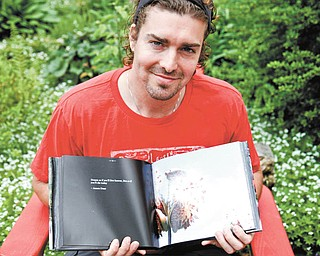 MADELYN P. HASTINGS I THE VINDICATOR  Youngstown State University civil-engineering major Joshua Rupe's love for photography has taken him on countless trips through Mill Creek MetroParks — and afar — and has led to his getting two photography books published.
