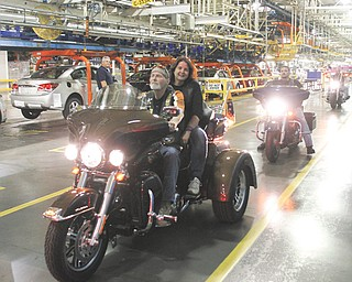 Randy Cramer, an employee at the General Motors Assembly Plant in Lordstown, and his wife, Vicky, were among those who rode their motorcycles into the facility as part of a March of Dimes fund drive.