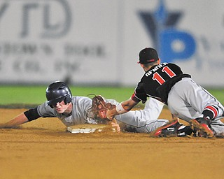Fitch's Luke Peterson avoids the tag by Chardon infi elder Mason Bender to reach second base on a steal during their Division I district semifinal baseball game Thursday at Cene Park in Struthers. After three rain delays, the Falcons ousted the Hilltoppers, 6-2.