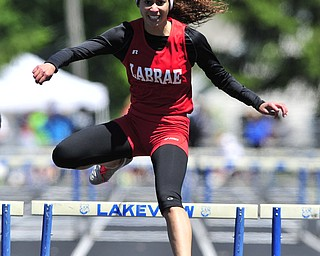 Labrare hurdler Megan Gunther clears the final hurdle on her way to finishing first during the girls 300 meter hurdles.
