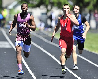 Mooney runner Jayshawn Coleman pulls away from Crestview runner Brendan Fannin and Lakeview runner Ben Biehl during while sprinting to the finish line during the boys 200 meter dash.