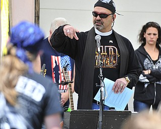 Reverend Jeff Baker gives his blessing of bikes and riders Saturday afternoon at Christ Episcopal Church in Warren.
