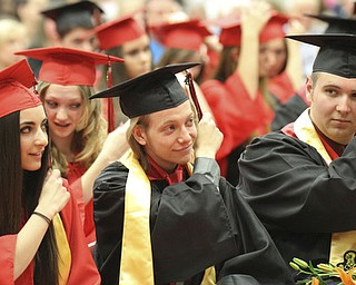William D. Lewis\The Vindicator.Girard HS valedictorians l-r Gia Mancini, Sam Horne and Ben Cario move tassells on their caps during Sunday commencement ceremony at Girard HS.